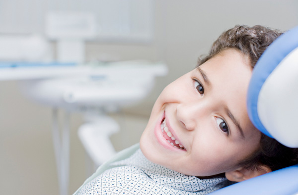 Young boy smiling with healthy teeth at Dr. Edwin A. McDonald D.D.S. in Plano, TX