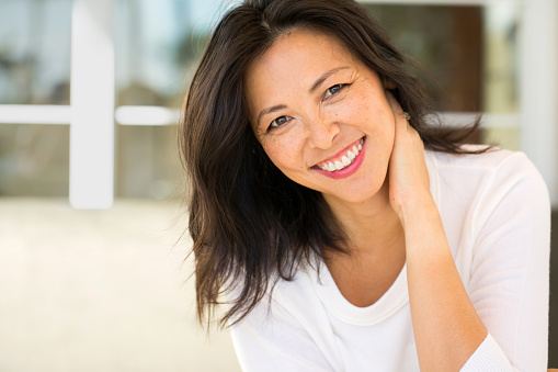 Middle Age Asian Woman Smiling from good visit to Dr. Edwin A. McDonald D.D.S.